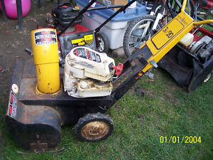 assortment of lawnmowers and snow blowers for fix
