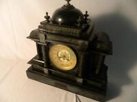 Victorian slate mantle clock with key.