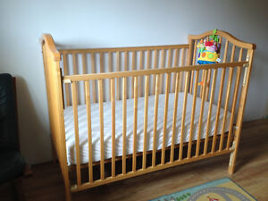 Solid Crib in perfect condition and baby mobile in picture