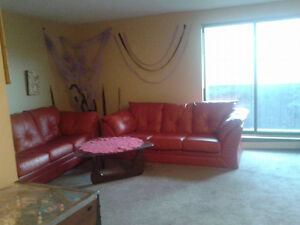 Red faux leather sofa bed London Ontario image 1
