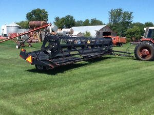 30 foot Prairie Star Macdon pull type swather.