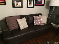 Matching leather couch and loveseat