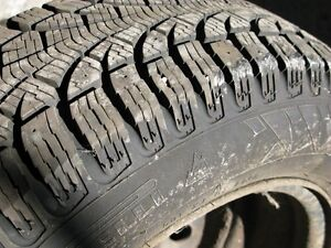 4 Pirelli Winter Carving 185/65R14 on steel rims w/wheel covers West Island Greater Montréal image 6
