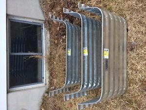 3 new metal window wells