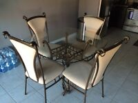 Rod iron and glass table with four chairs