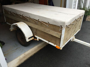 Utility trailer with cover
