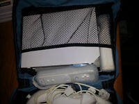 Wii  System with Sports Package and Carrying Case