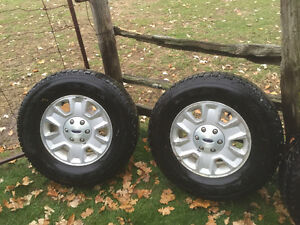 Firestone winter force tires and Ford  aluminum rims