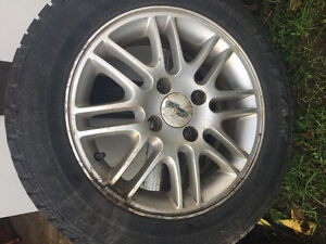 4 15 inch Ford 4x100 factory alloy rims.