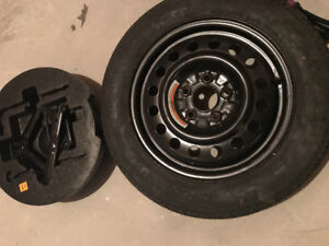 Tire and Car Jack: Spare donut tire and Car jack