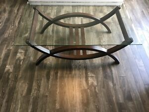 Glass top coffee table with wood base