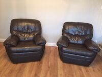 TWO DARK BROWN RECLINING LEATHER CHAIRS