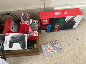 Nintendo Switch Blue/Red (unopened), Pro Controllers, Wheels