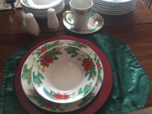 Setting of seven Christmas dishes .
