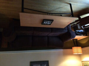 Brown couch 3 tables 2 lamps
