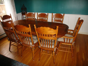 For sale - Solid wood dining room table with eight chairs.
