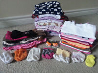 Bag of girl clothes 0-3 month and diapers