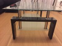 Glass and gloss black coffee table