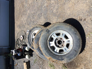 245 /70 16 tires and rims off 2001 Chevy 1500