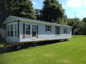 1991 Parkwood 12 X 40 Mobile Home with axles & tires