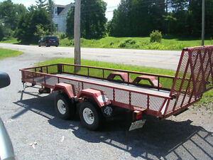 14 foot tandem axle scott built trailer with double hinged ramp.
