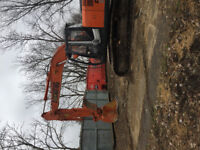 Excavator and skid steer for hire.