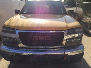 GMC Canyon 2004 and Dodge Caliber 2007