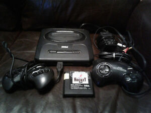 Selling Sega Genesis console with two controllers and hockey gam
