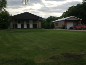 Newer 1 bedroom home on 1 acre parcel with large shop