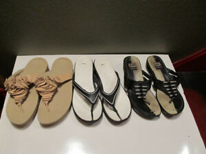 Various womens flip-flop sandals.