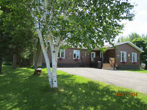 Huge 4 bedroom ENERGY EFFICIENT bungalow on 2 acres Wooded Lot