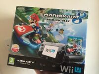 Nintendo Wii U boxed, with games