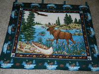 A NEW GREEN BORDERED MOOSE WALL HANGING