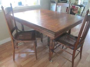 100++   year old Oak Table & 3 Oak chairs with cane seats