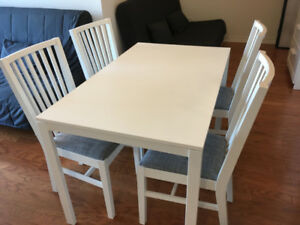 4 white Norrnas dining chairs, perfect condition