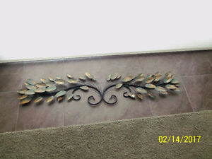Beautiful sophisticated wall art with green/bronze/gold leaves.