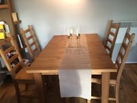Free - A set of 4 solid wood dining chairs only