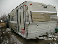 22 Foot camping trailer loaded with flea market/ yard sale items