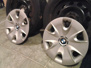 "BMW 16"" Rims and OEM wheel covers in great shape ."