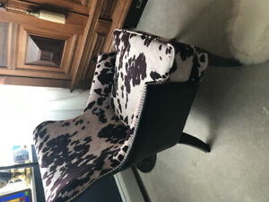 Beautiful  and stylish occasional chair with a faux cow print!