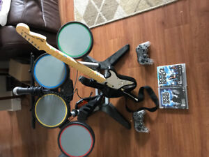 PS3 Rockband 1 & 2 drum set, guitar, Mic, 2 controllers