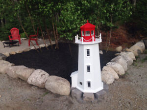 Drilled well pipe cover of Peggy's Cove with solar lighting