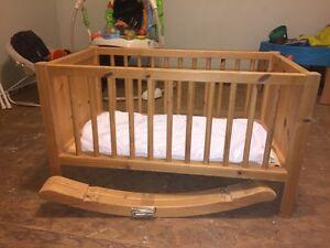 Rocking or stationary wooden bassinet