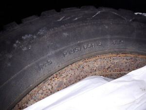 Four 195/65/15 Winter Tires on Rims from a Pontiac Sunfire