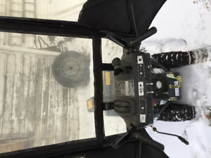 Snow blower with canopy
