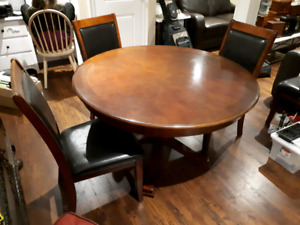 Round solid wood dining set with four chairs