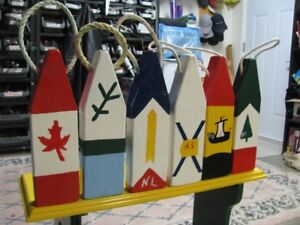 Decorative Lobster Trap Buoys Painted in Provincial Flag Colors