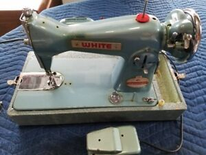 White sewing machine with many extras included