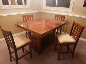 Beautiful solid wood pub style table and chairs