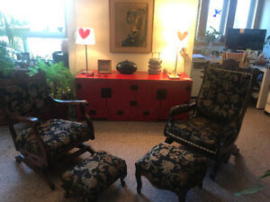 Elegant antique rocking chairs with footrests